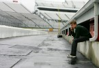Carl sits behind the garage area at Martinsville Raceway on the cell phone after the testing was canceled due to inclement weather
