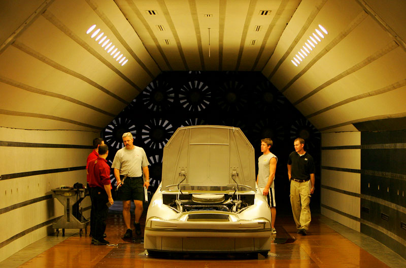 Carl and his dad stop by the wind tunnel at Roush Racing. Technicians examine and test the car's aerodynamnics