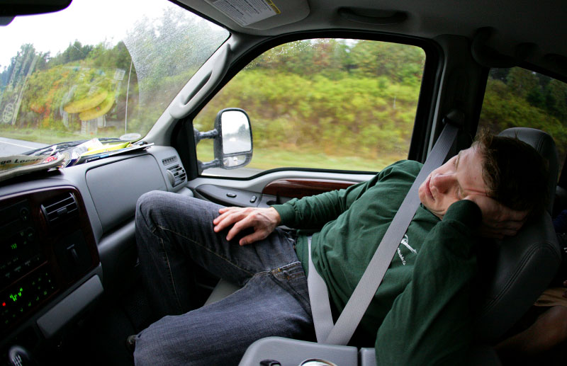 Carl sleeps on the passenger side of his truck on his way to Martinsville Raceway for testing.