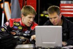 Carl goes over data with Roush engineer Jason Stockert in the garage during testing