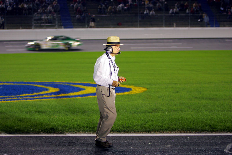 Car owner Jack Roush keeps a watchful eye from pit row as Carl makes his qualifying run
