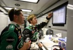 Carl reviews data with a crew member between practice runs inside the team's transport hauler