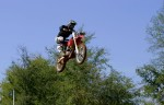 Carl gets elevated on his dirt bike showing the same skills he has as a superstar NASCAR driver