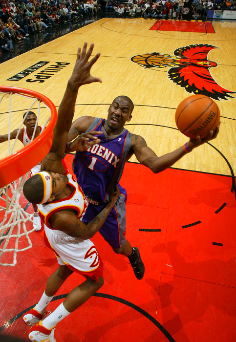 Phoenix Suns Amare Stoudemire  goes to the basket against Josh Smith of the Atlanta Hawks