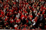Students celebrate on the floor as Maryland defeated Duke