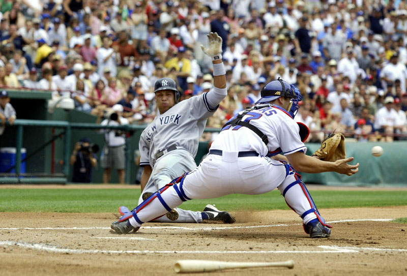 New York Yankees Alex Rodriguez attempts to score against Texas Rangers catcher Rod Barajas