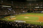 Flash bulbs fire at the first pitch as the New York Yankees meet the Florida Marlins in the 2003 World Series at Pro Player Stadium