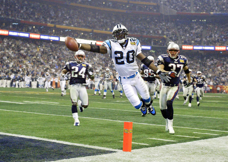 Carolina Panthers DeShaun Foster leaps over the goaline scoring a touchdown against the New England Patriots in Super Bowl XXXVIII