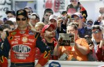Jeff Gordon stand in his garage as fans gather to catch a glimpse