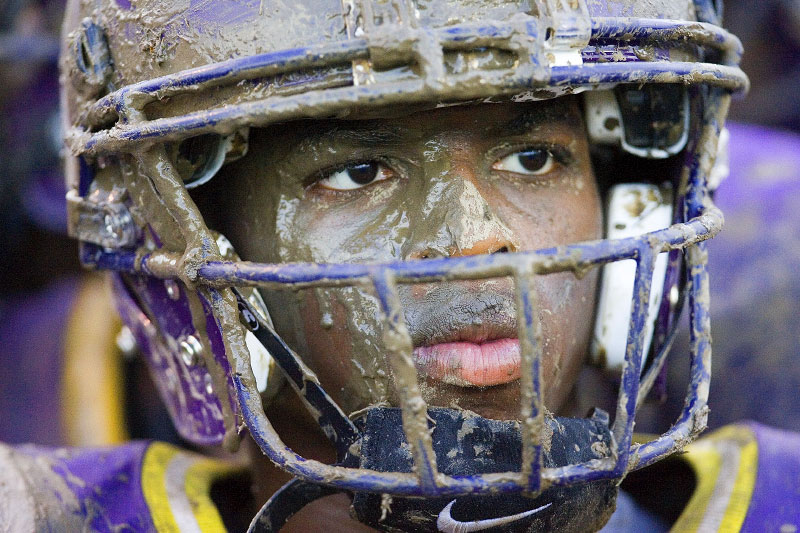 game day st ine high school photo essays  senior joe gaskins stands along the sidelines covered in mud during the game against shaw