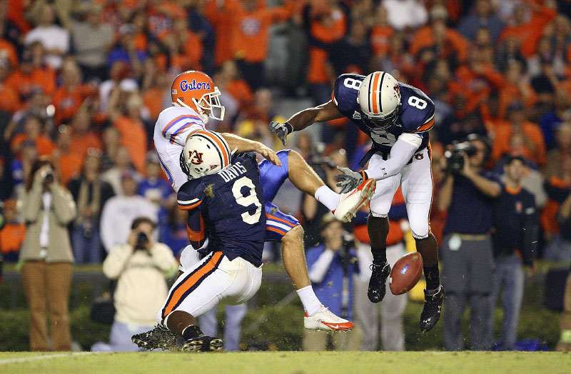 Auburn Tigers Jerraud Powers and Tristan Davis block a  punt against Florida Eric Wilbur which was returned for an Auburn touchdown