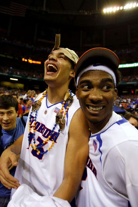 Florida's Joakim Noah and Corey Brewer celebrate their back to back National Championship against Ohio State