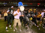 South Florida coach Jim Leavitt gets victory bath after upsetting Louisville.