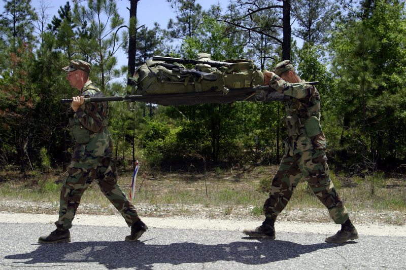 Two man Ranger teams engage in a three mile litter carry.