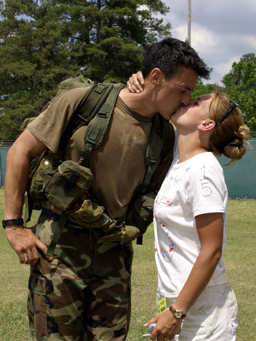 USA Ranger Staff Sgt. Adam Nash kisses his wife after winning the 60 hour non-stop competition and the 2004 Army's Best Ranger.