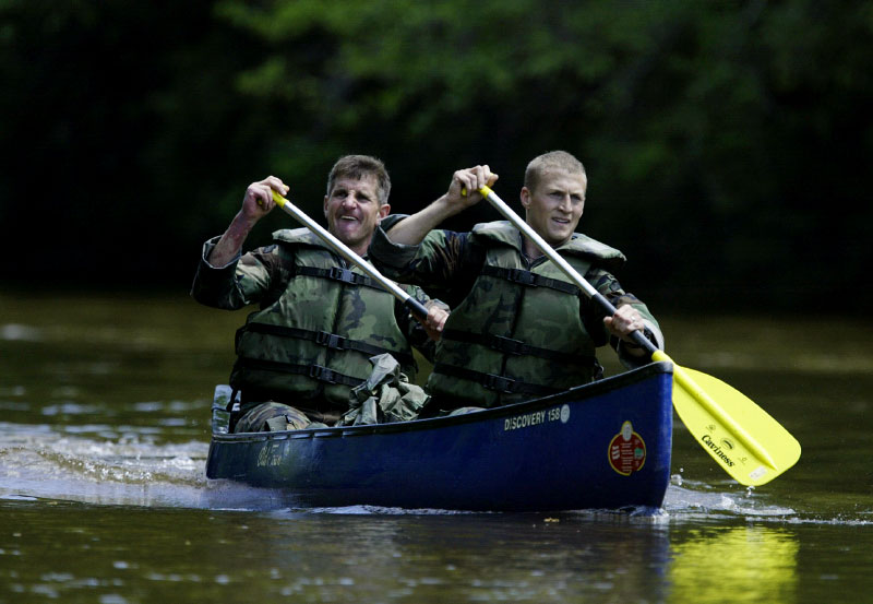 USA Army Rangers Matthew Wilson and John Shaeffer navigate their canoe down the river.