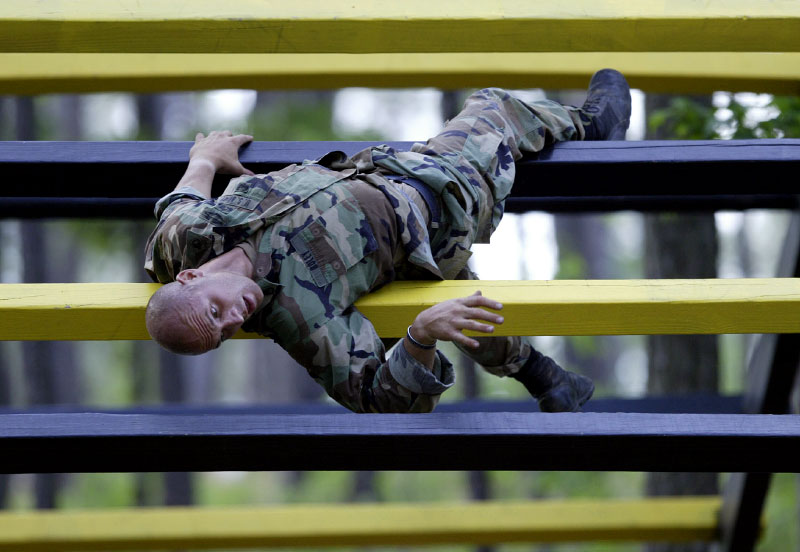 USA Army Ranger Colin Boley takes his turn as he naviagtes through the Darby Queen obstacle course.