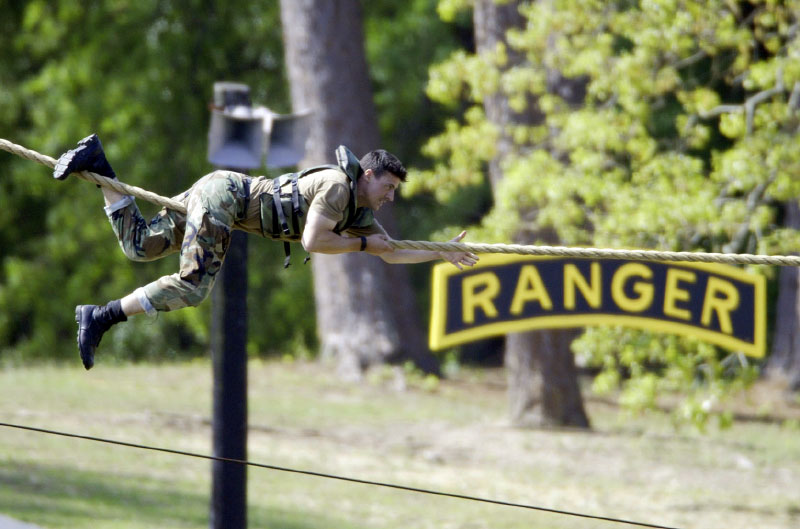 USA Ranger Adam Nash slides down a rope during the water skills competition.