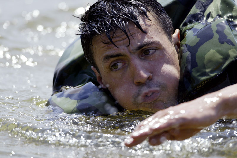 Staff Sgt. Adam Nash swims with his gear attached during the Helo Cast.
