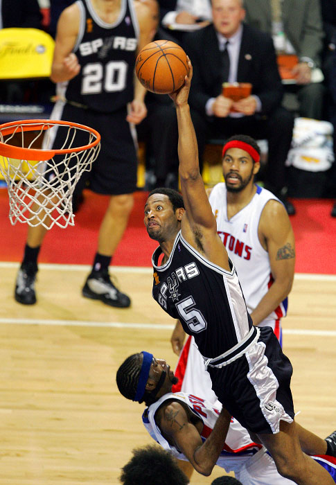 San Antonio Spurs Robert Horry making dunk as he colides with Detroit Pistons Richard Hamilton in overtime during game 5