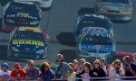 NASCAR fans watch the race in front a large jumbotron