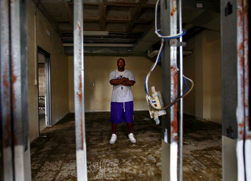 St. Augustine Purple Knights head coach Wayne Cordova stands in the training room adjacent to their weight room which was damaged by 5 feet of water from Katrina.
