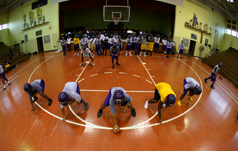 Heavy rain forced the team to conduct their final practice before the first game in the school's gym.