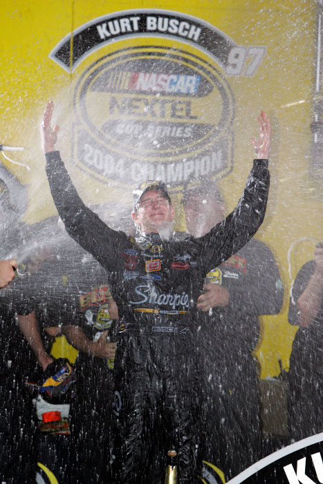 NASCAR driver Kurt Busch celebrates winning the 2004 NASCAR Championship at Homestead Motorspeedway