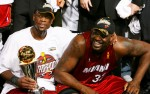 Miami Heat Shaquille O'Neal and Dwyane Wade victorious with his MVP trophy after winning the 2006 NBA Championship against the Dallas Mavericks