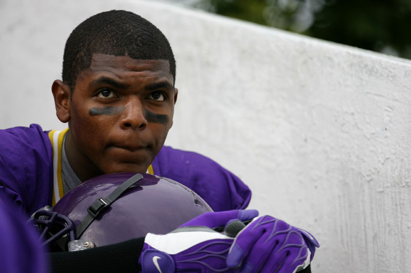 As the team awaits their time to play in the City Park Jamboree, senior strong safety Deron Lacour displays a pensive look.