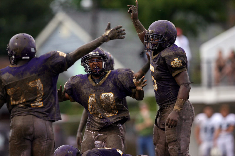 Players react to recovering a fumble early in the game against Shaw.