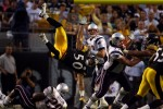 Pittsburgh Steelers Larry Foote is upended as his rushes New England Patriots quarterback Tom Brady as he sets to throw at Heinz Field