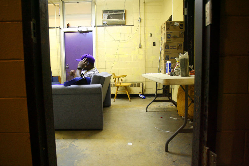 Coach Wayne Cordova, who was living in a FEMA trailer, makes a call from his office next to the Purple Knights locker room.