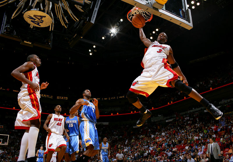 Miami Heat guard Dywane Wade dunks the ball against the Denver Nuggets