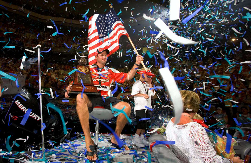 Professional bass fisherman Kevin VanDamm celebrates winning the Bassmaster Classic.