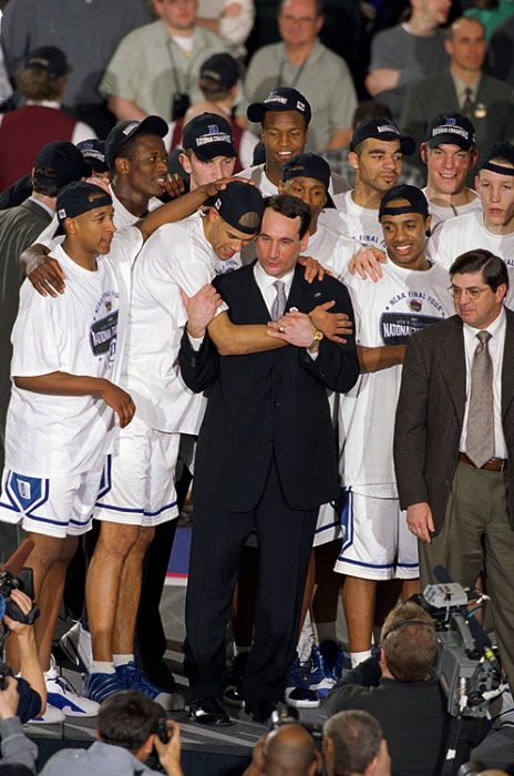 Duke's Shane Battier hugging coach Mike Krzyzewski after deating Arizona to win the National Championship