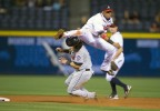 Atlanta Braves shortstop Yunel Escobar collides with New York Mets Ryan Church as he turns a double play at Turner Field