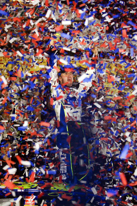 Jimmie Johnson victorious as confetti falls in victory lane after winning the Daytona 500
