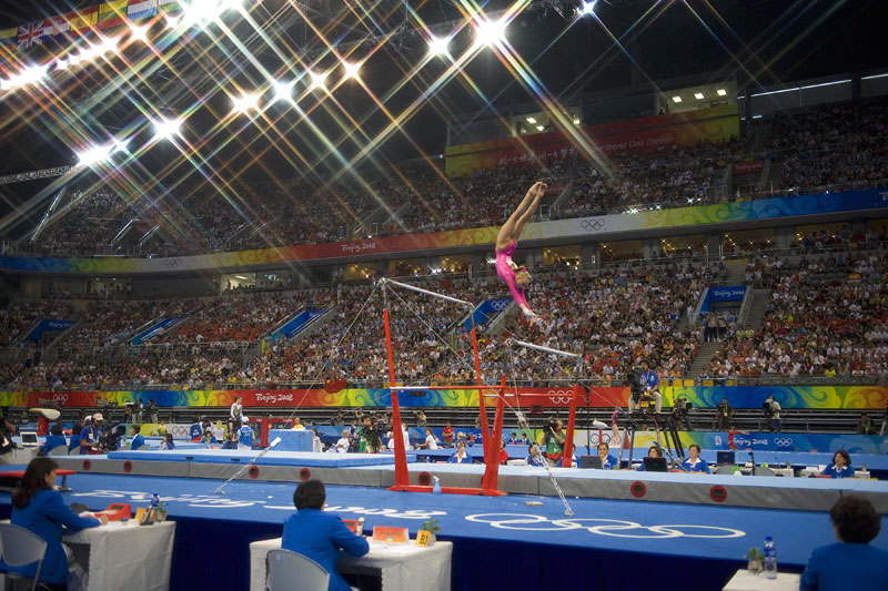 Unites States gymnast Nastia Liukin performs on the uneven bars en route to her gold medal finish in the women's all around individual finals at the Beijing Summer Olympic Games