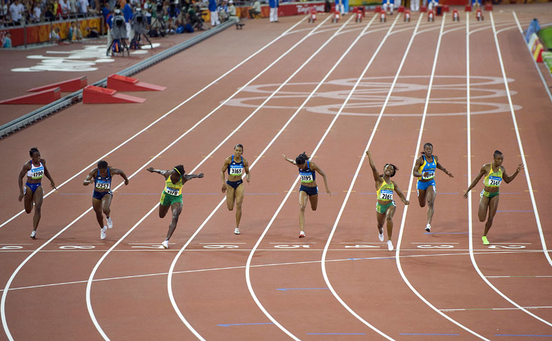 Shelly-Ann Fraser (2165) of Jamaica celebrates as she wins the gold medal in the women's 100m final at National Stadium during the Beijing Summer Olympic Games