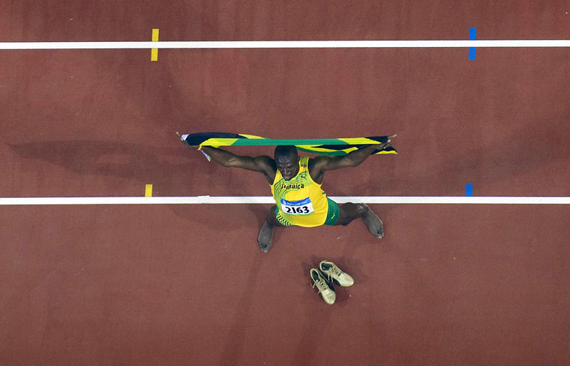 An overhead view of Usain Bolt of Jamaicia as as he celebrates a new world record after winning the men's 100m final at Olympic Stadium at the Beijing Summer Olympic Games.