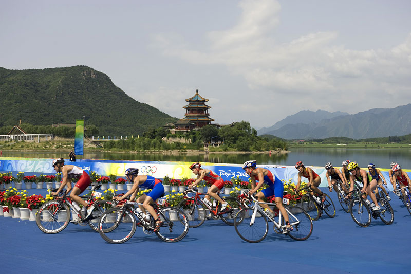 Competitors make the turn during the cycling stage of the womens triathlon at Ming Tomb Reservoir during the Beijing Summer Olympic Games.