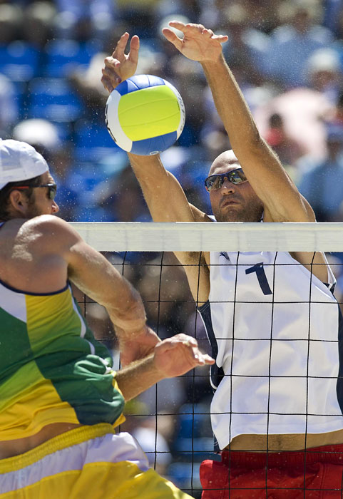Phil Dalhausser (USA), right, blocks a shot by Fabio Magalhaes (BRA) during the mens beach volleyball gold medal match at the Chaoyang Park Beach Volleyball Ground during the Beijing Summer Olympic Games