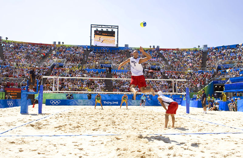 Phil Dalhausser (USA), serves against Brazil during the mens beach volleyball gold medal match at the Chaoyang Park Beach Volleyball Ground during the Beijing Summer Olympic Games
