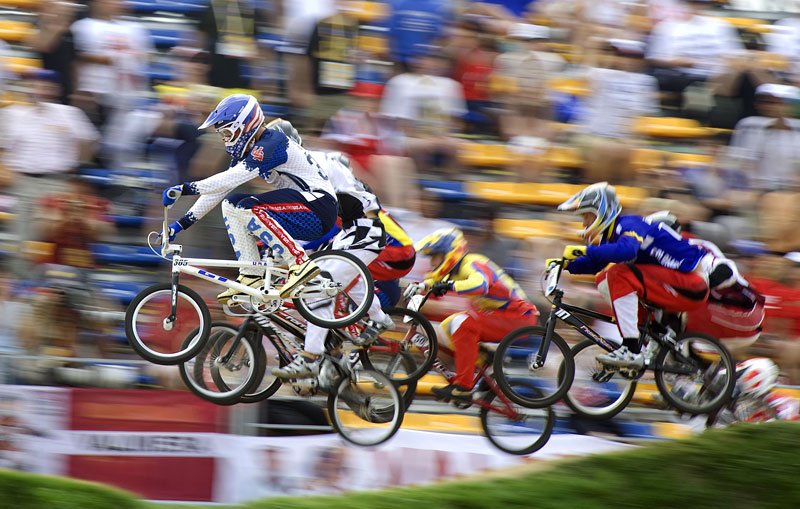 USA cyclist Mike Day leads the field of riders over a jump during the BMX cycling at the Laoshan Moto Cross Venue in the Beijing Summer Olympic Games.