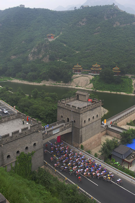 Cyclists make their way through the Great Wall of China during the cycling race on day one of the 2008 Beijing Summer Olympic Games.