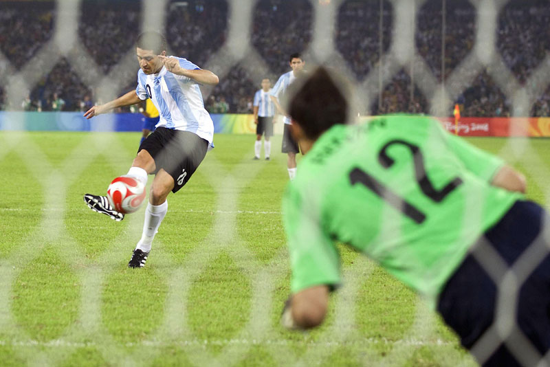 Argentina midfielder Juan Riquelme (10) scores on a penalty kick against Brazil goalie Renan (12) during the semifinal round match at Workers Stadium during the Beijing Summer Olympic Games