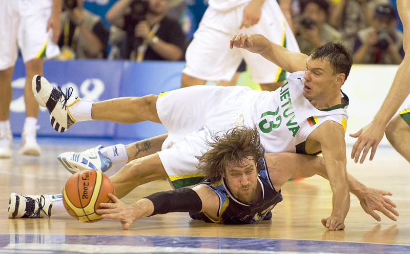 Sarunas Jaikevicius of Lithuania coliides with Andres Nocioni of Argentina during the men's bronze medal match during the Beijing Summer Olympic Games.