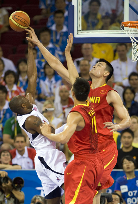 China center Yao Ming blocks a shot by USA guard Kobe Bryant during their first round game during the Beijing Summer Olympic Games.