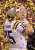 LSU quarterback Matt Flynn celebrates winning the National Championship against Ohio State as he kisses the trophy